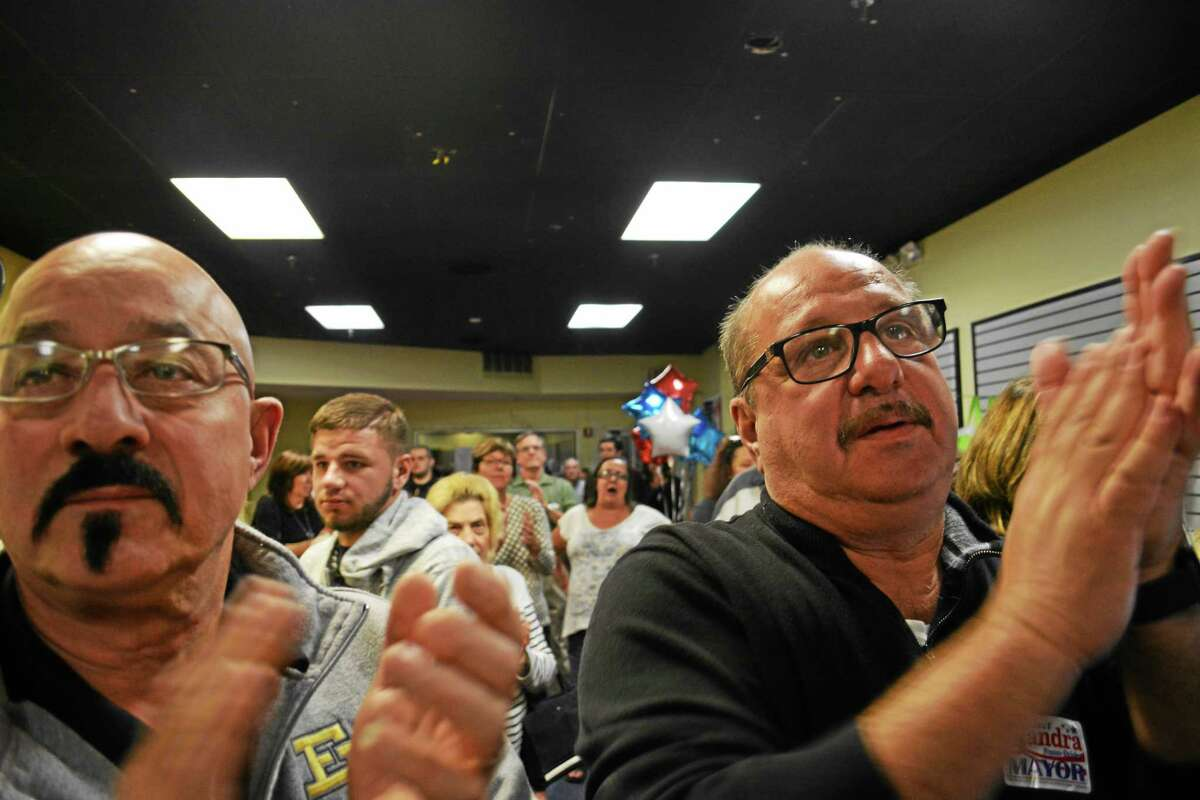 Crowds gather on Election Day to hear the results come in for the respective candidates. While Democrats won the most victories Tuesday, Republicans cheered their winners as well at headquarters.