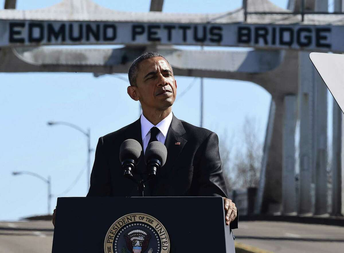 """President Barack Obama speaks near the Edmund Pettus Bridge, Saturday, March 7, 2015, in Selma, Ala. This weekend marks the 50th anniversary of """"Bloody Sunday,"""" a civil rights march in which protestors were beaten, trampled and tear-gassed by police at the Edmund Pettus Bridge, in Selma. (AP Photo/Bill Frakes)"""