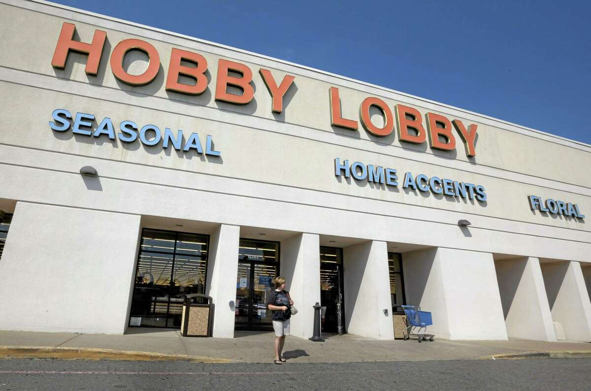 In this 2012 file photo, a woman walks from a Hobby Lobby store in Little Rock, Ark.
