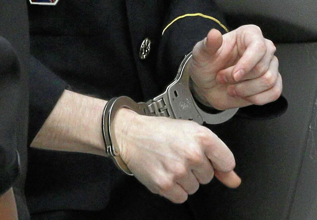 Army Pfc. Bradley Manning wears handcuffs as he is escorted into a courthouse in Fort Meade, Md., Wednesday, Aug. 21, 2013, before a sentencing hearing in his court martial. Manning was sentenced Wednesday to 35 years in prison for giving hundreds of thousands of secret military and diplomatic documents to WikiLeaks.