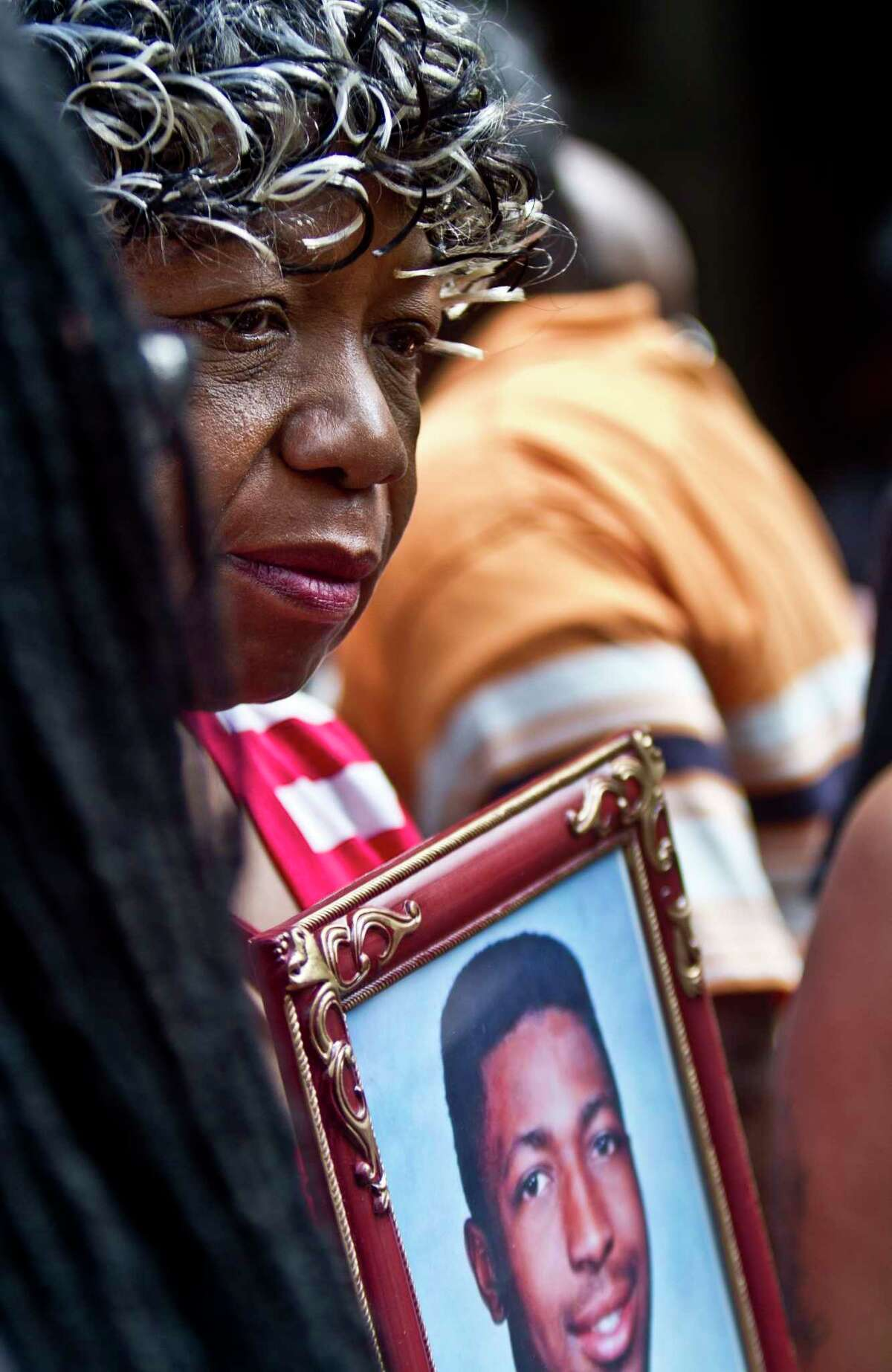 Gwen Carr holds a picture of her son Eric Garner during a news conference July 7 in New York with relatives of New Yorkers killed by police.