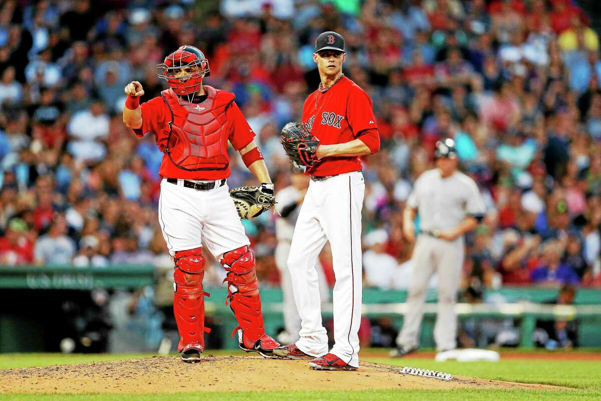The Boston Red Sox exercised a $13 million option on pitcher Clay Buchholz.