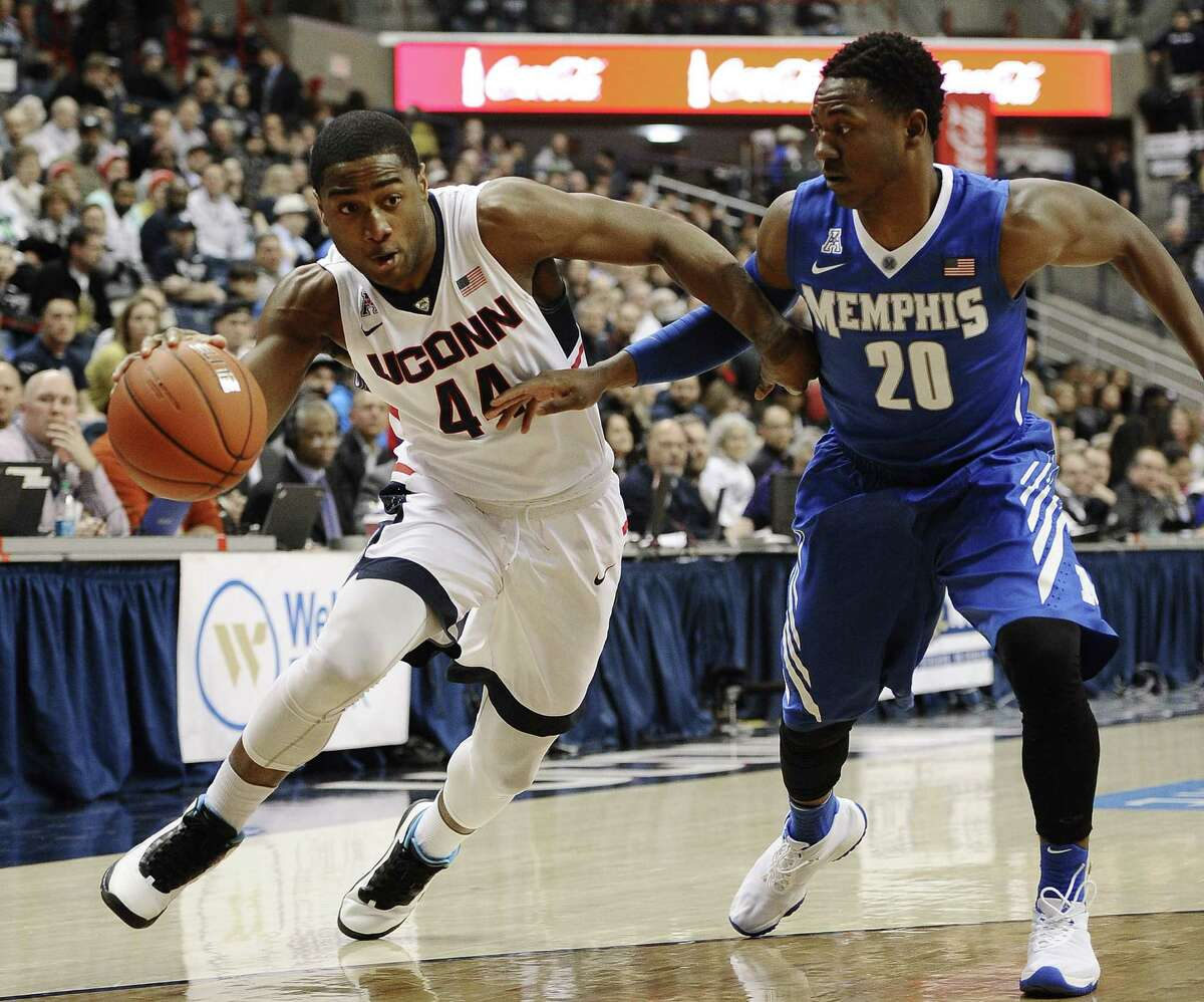 UConn's Rodney Purvis dribble drives as Memphis' Avery Woodson defends during Thursday's game in Storrs.
