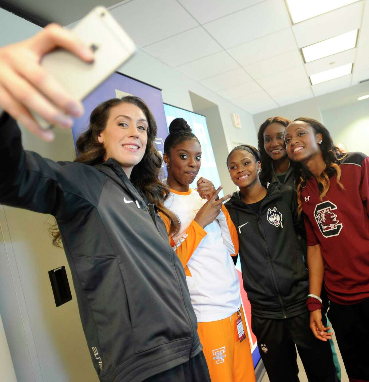 UConn's Breanna Stewart, left, takes a photo with, from left, Tennessee's Diamond DeShields, UConn's Moriah Jefferson, Baylor's Nina Davis and South Carolina's Tiffany Mitchell during NCAA women's basketball media day on Tuesday at ESPN in Bristol.