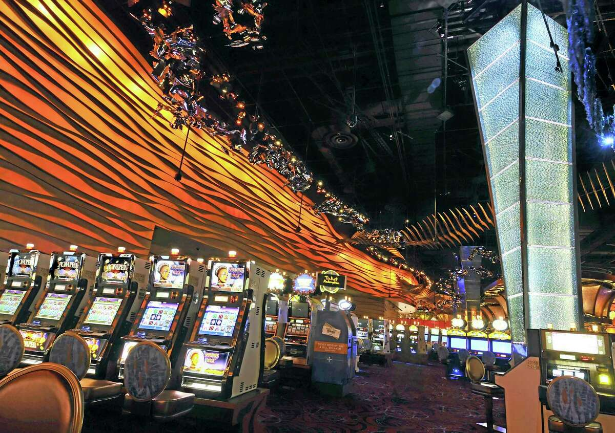 FILE - This Aug. 26, 2008 file photo, shows slot machines on the floor of the new Casino of the Wind at Mohegan Sun in Uncasville, Conn. (AP Photo/Jessica Hill, File)