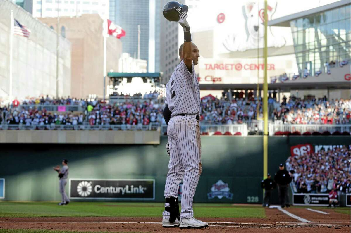 Shortstop Derek Jeter, of the New York Yankees, waves to the crowd during the first inning of the MLB All-Star baseball game, Tuesday, July 15, 2014, in Minneapolis. (AP Photo/Jim Mone)
