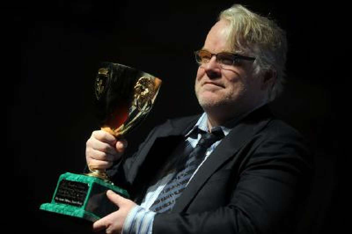 """Philip Seymour Hoffman poses with the Coppa Volpi for the Best Actor he received for """"The Master""""at the 69th Venice Film Festival on Sept. 8, 2012."""