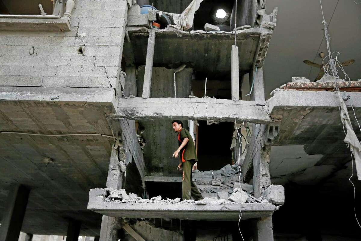 A Palestinian looks at the damage to a house following an overnight Israeli missile strike in Gaza City on July 15, 2014. Egypt presented a cease-fire plan Monday to end a week of heavy fighting between Israel and Hamas militants in the Gaza Strip that has left at least 185 people dead, and both sides said they were seriously considering the proposal. The late-night offer by Egypt marked the first sign of a breakthrough in international efforts to end the conflict.