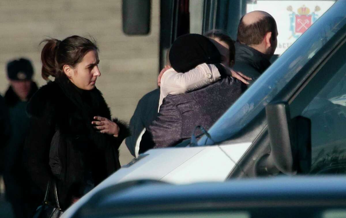 Relatives stand at a facility, where identification of plane crash victims is held, in St. Petersburg, Russia on Nov. 3, 2015. The first 10 bodies of victims of Saturday's plane crash over Egypt were identified by their families Tuesday.