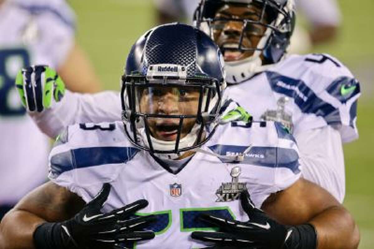 Seattle Seahawks outside linebacker Malcolm Smith (53) reacts after running back an interception for a touchdown against the Denver Broncos during the first half of the NFL Super Bowl XLVIII football game, Sunday, Feb. 2, 2014, in East Rutherford, N.J