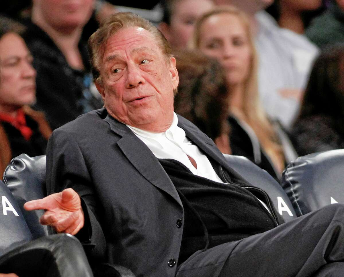 In this Dec. 19, 2011, file photo, Los Angeles Clippers owner Donald Sterling gestures while watching the Clippers play the Los Angeles Lakers in Los Angeles. Sterling got his 15 minutes of shame in May ask he was heard making racist comments to a woman described as his girlfriend.