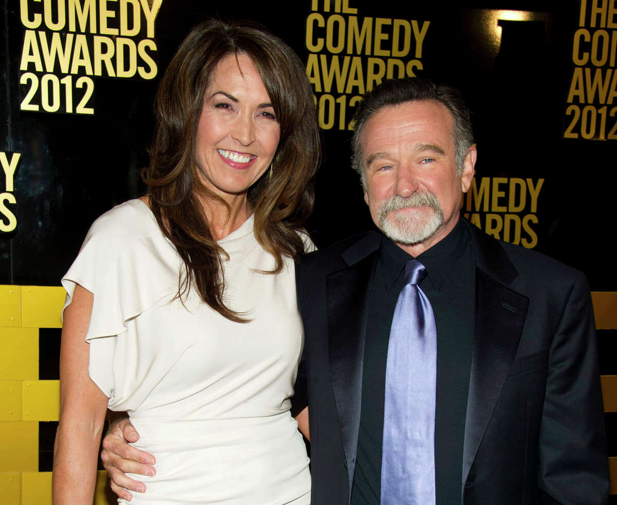 """FILE - In this April 28, 2013, file photo, Robin Williams, right, and his wife Susan Schneider arrive to The 2012 Comedy Awards in New York. Schneider said Williams' medical afflictions would have claimed his life within three years _ """"hard years"""" _ and that she doesn't blame him for his suicide. The actor-comedian had not only been diagnosed with Parkinson's disease, a progressive movement disorder, a few months before his death, but also that a coroner's report found signs of Lewy body dementia, a difficult-to-diagnose condition that leads to a decline in thinking and reasoning abilities."""