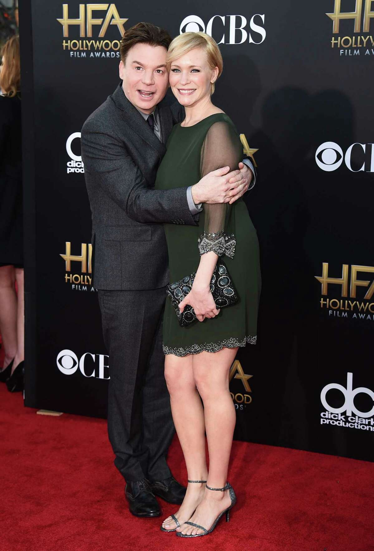 In this Nov. 14, 2014, file photo, Mike Myers, left, and Kelly Tisdale arrive at the Hollywood Film Awards at the Palladium in Los Angeles. A spokeswoman for Myers said that Kelly gave birth Monday, Nov. 2, 2015, to their daughter Paulina Kathleen in New York City.