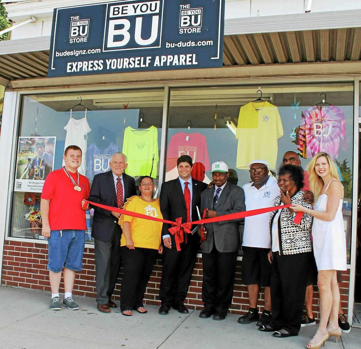 EJ's Empire and BU Design's grand opening June 30 on East Main Street, Middletown, was attended by Joey Pizzo, Chamber President Larry McHugh, Joyce Harrell, Mayor Dan Drew, James Young, the Rev. Willie Young, Minister Judy Young and Candace Klaneski.