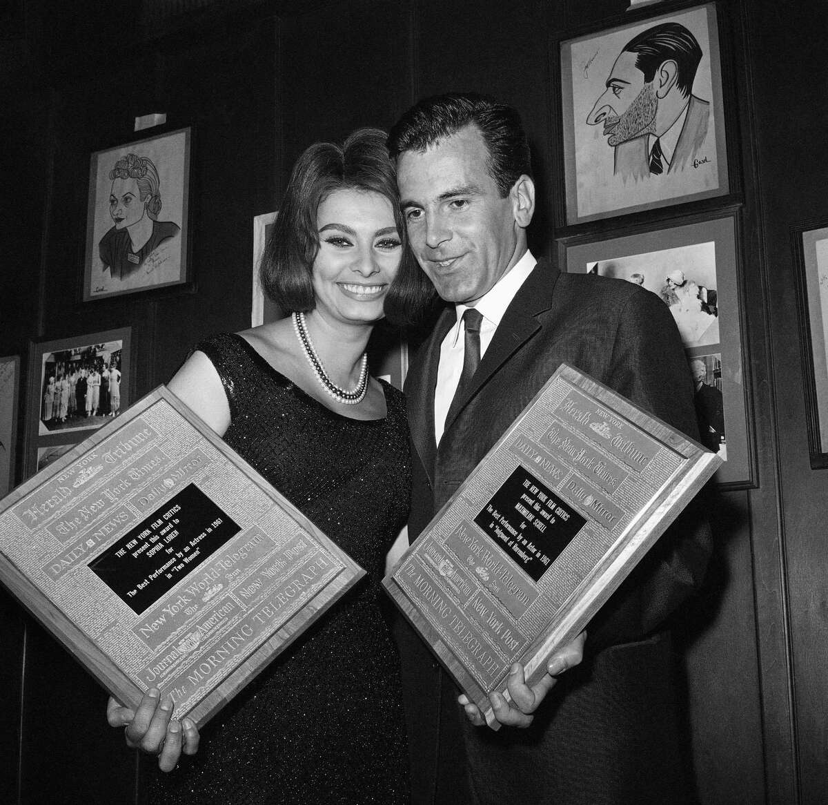 """FILE - In a Jan. 20, 1962 file photo, Maximilian Schell and Sophia Loren hold awards presented to them in New York by the New York Film Critics Circle. Schell was cited as best actor of 1961 for his role in """"Judgment at Nuremberg."""" Loren was acclaimed best actress of 1961 for her part in the movie """"Two Women."""""""
