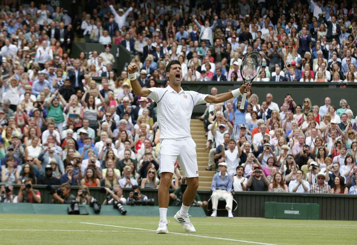 Novak Djokovic of Serbia celebrates winning the men's singles final against Roger Federer of Switzerland at Wimbledon Sunday.