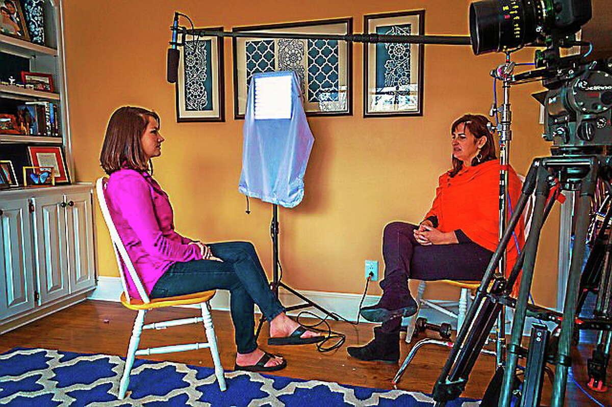 """Filmmaker Linda Midgett, right, interviews Meghan Blanton Smith for the documentary film """"The Stranger."""""""