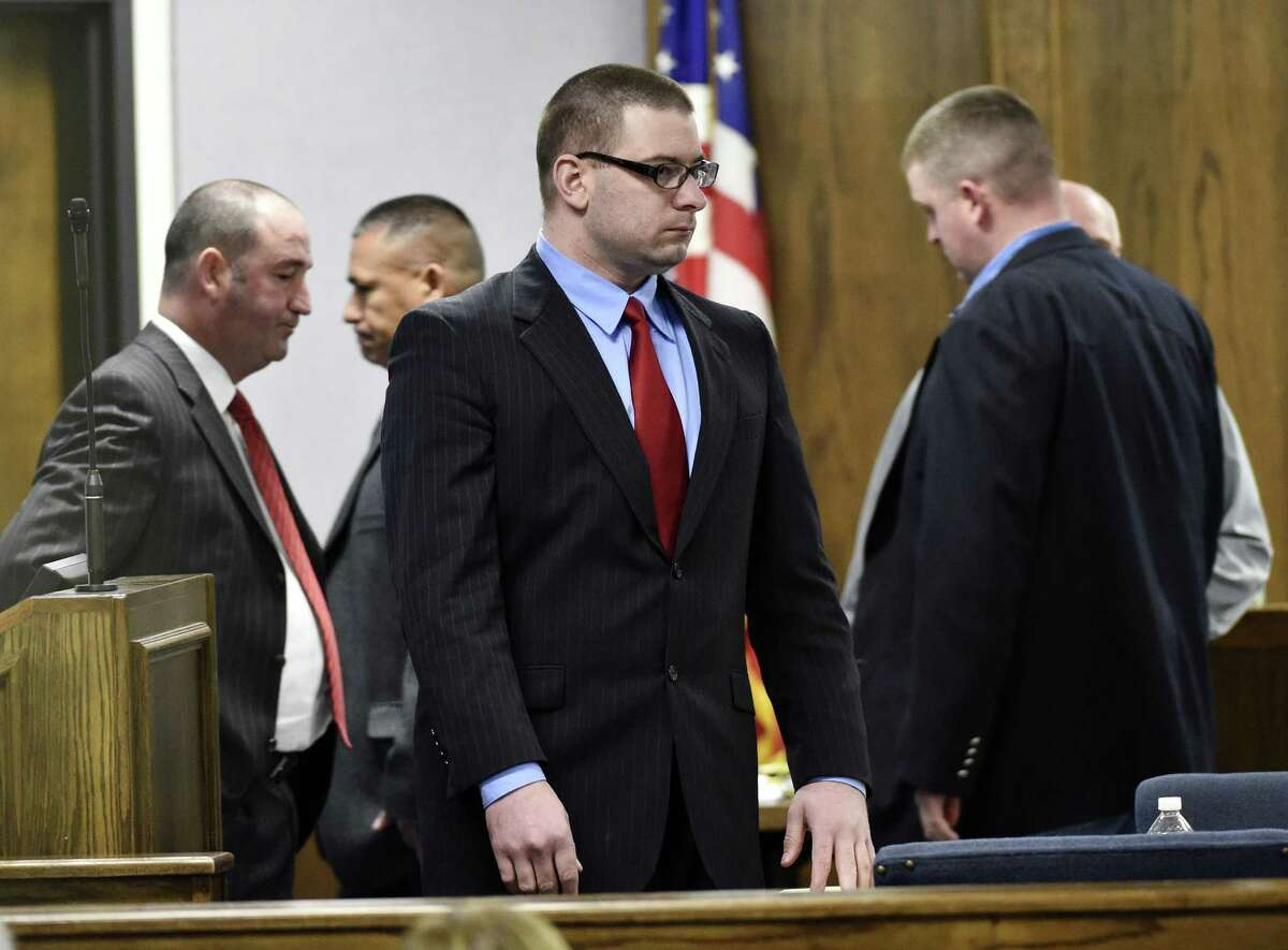 Former Marine Cpl. Eddie Ray Routh stands during his capital murder trial at the Erath County, Donald R. Jones Justice Center in Stephenville Texas, on Tuesday, Feb. 24, 2015. Routh, 27, of Lancaster, is charged with the 2013 deaths of Chris Kyle and his friend Chad Littlefield at a shooting range near Glen Rose, Texas. (AP Photo/The Dallas Morning News, Michael Ainsworth, Pool)
