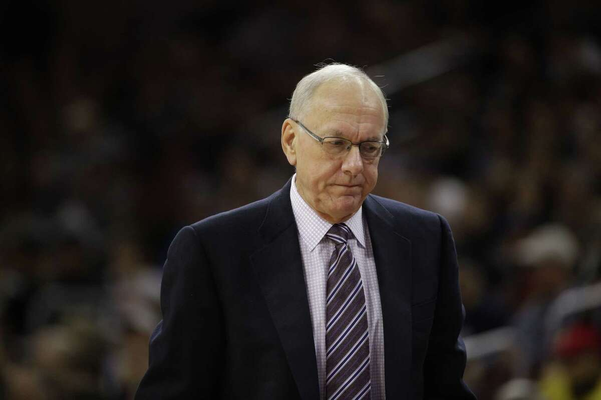 In this Dec. 20, 2014, file photo, Syracuse head coach Jim Boeheim reacts during an NCAA college basketball game against Villanova in Philadelphia. The NCAA has suspended Syracuse coach Jim Boeheim Friday, March 6, 2015, for nine games for academic, drug and gifts violations committed primarily by the men's basketball program.