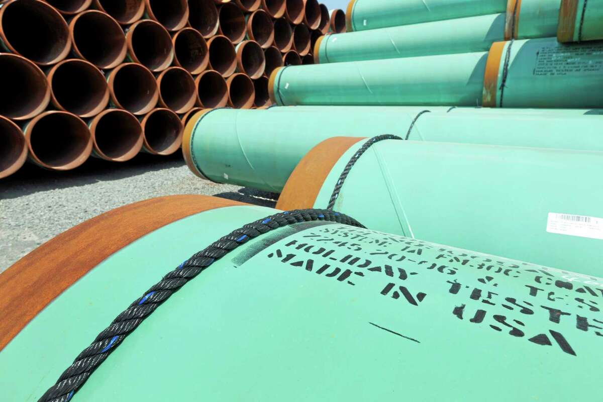 FILE - In this May 24, 2012 file photo, some of about 500 miles worth of coated steel pipe manufactured by Welspun Pipes, Inc., originally for the Keystone oil pipeline, is stored in Little Rock, Ark. In a move that disappointed environmental groups and cheered the oil industry, the Obama administration on Jan. 31, 2014, said it had no major environmental objections to the proposed Keystone XL pipeline from Canada. (AP Photo/Danny Johnston)