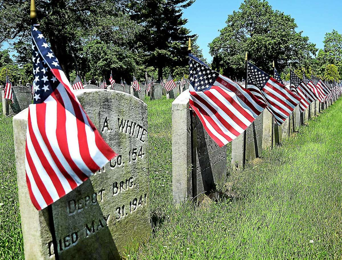 Veterans graves are decorated with flags to mark Memorial Day in the Field of Honor in Greenwood Cemetary in Hamilton. gregg slaboda photo