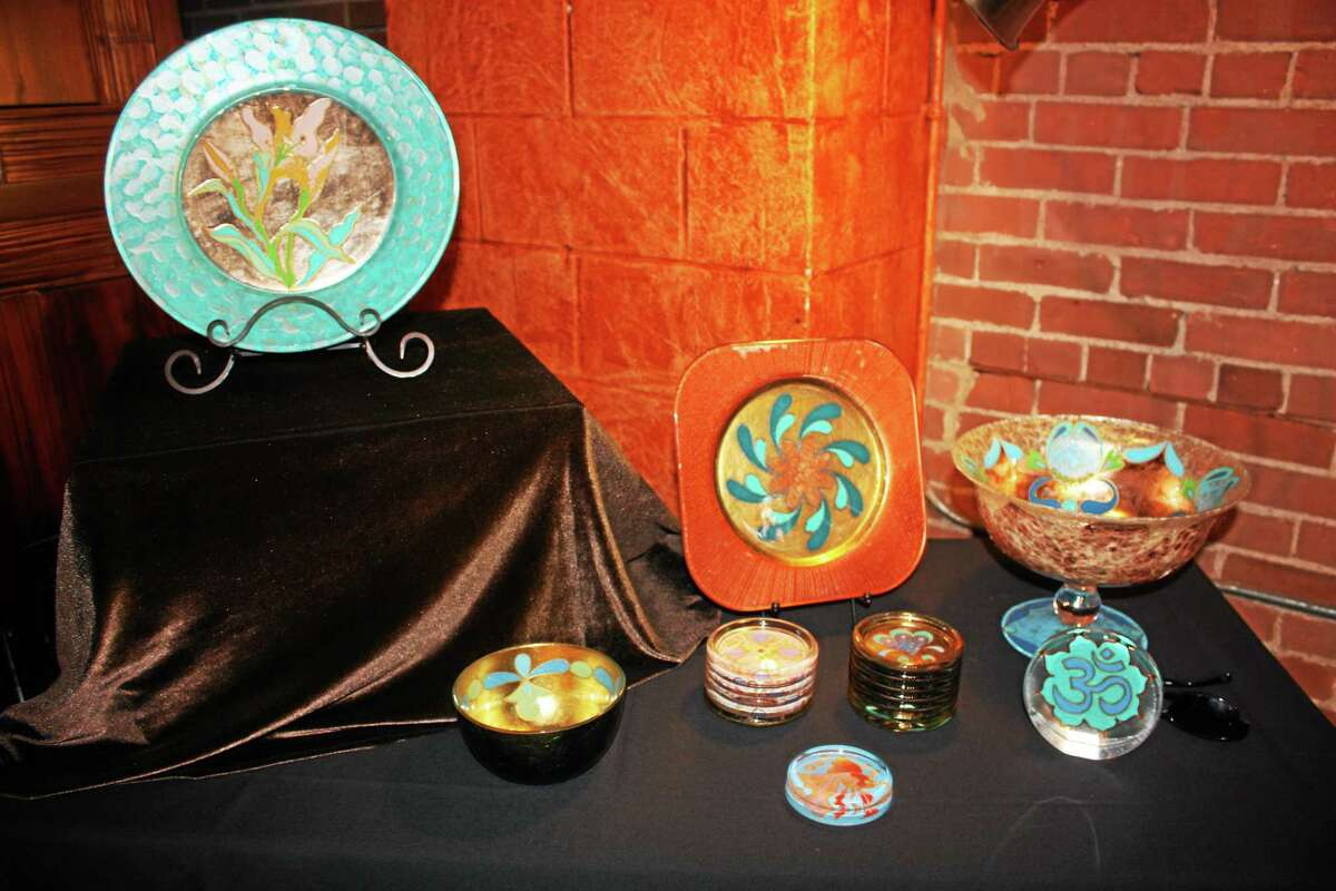 Submitted photo. Alexandra Ortiz of Middletown exhibits her hand painted glassware at the Buttonwood Tree at 605 Main St.