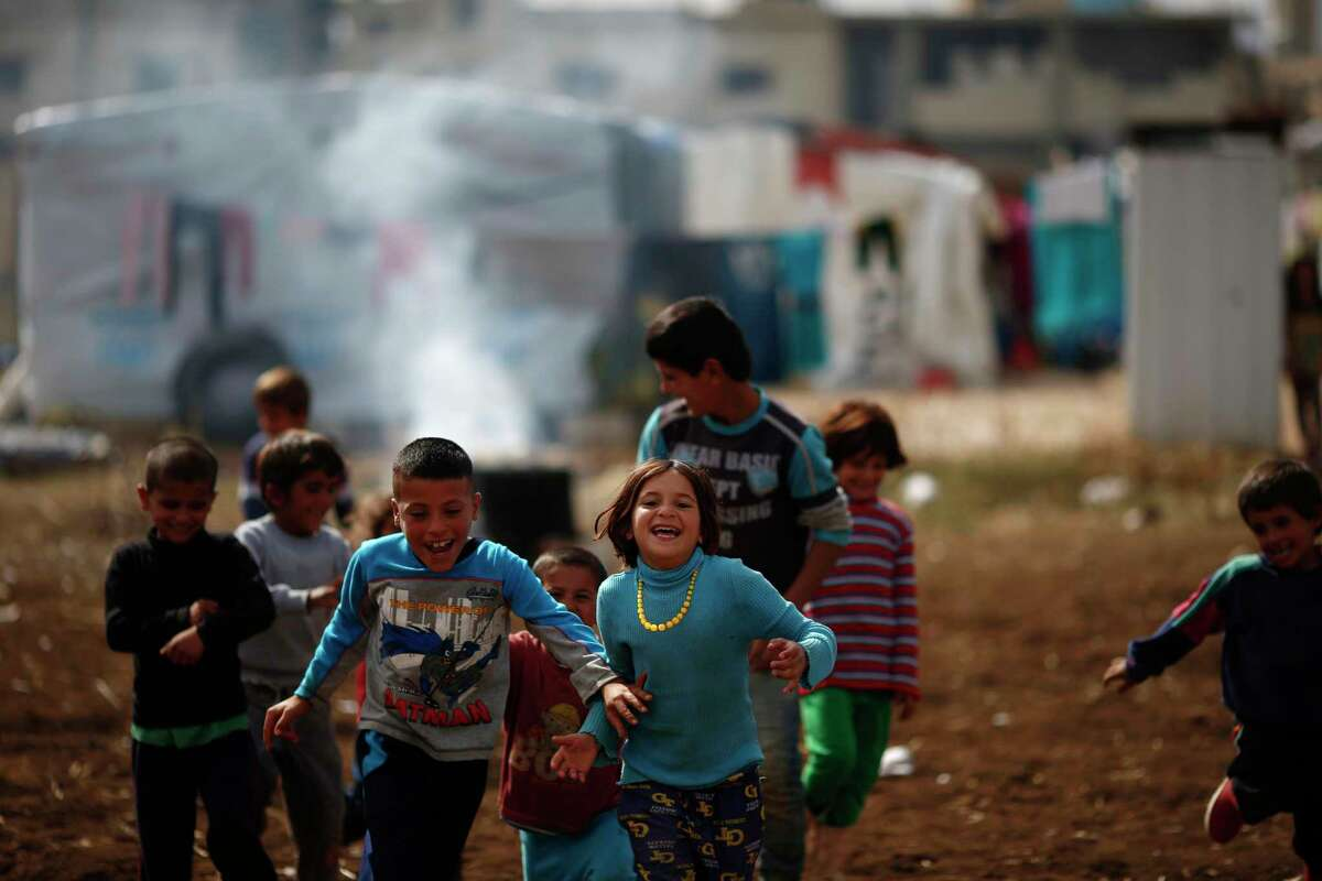 Syrian refugee boys play Oct. 28 at a refugee camp in the town of Hosh Hareem, in the Bekaa valley, east Lebanon. The United Nations said Tuesday the worsening conflict in Syria has left 13.5 million people in need of aid and some form of protection, including more than six million children.