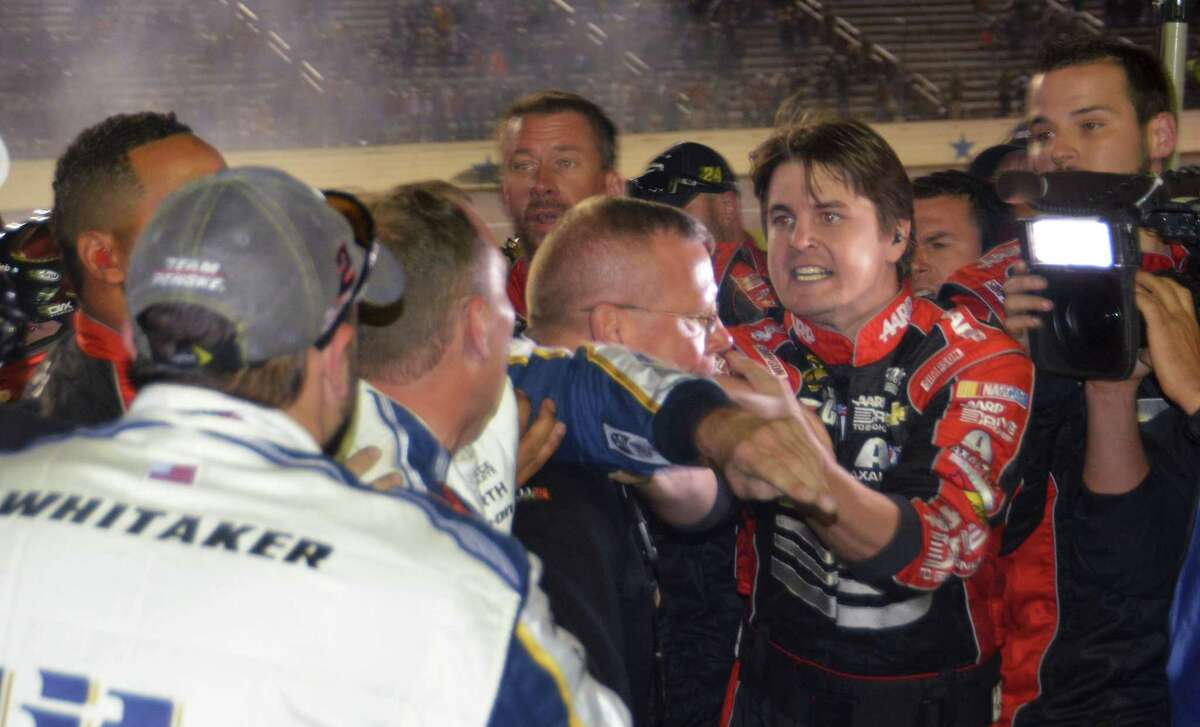 Pit crew members of drivers Jeff Gordon and Brad Keselowski fight on pit row after the end of the NASCAR Sprint Cup race on Sunday at Texas Motor Speedway in Fort Worth.