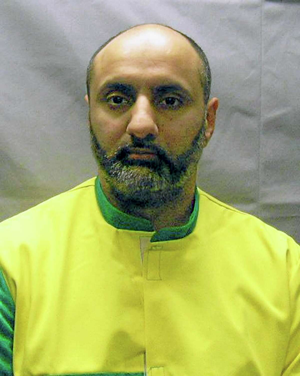 This Nov. 9, 2012, file photo provided by the U.S. Attorney's Office shows Babar Ahmad, extradited with Syed Talha Ahsan to the United States from Britain in October 2012 on charges of supporting terrorists. The men, both British citizens, have pleaded guilty to the charges. Ahmad faces sentencing Wednesday, July 16, 2014, in New Haven, Conn., for supporting terrorists through websites that sought to raise cash, recruits and solicit items such as gas masks for the Taliban regime in Afghanistan.