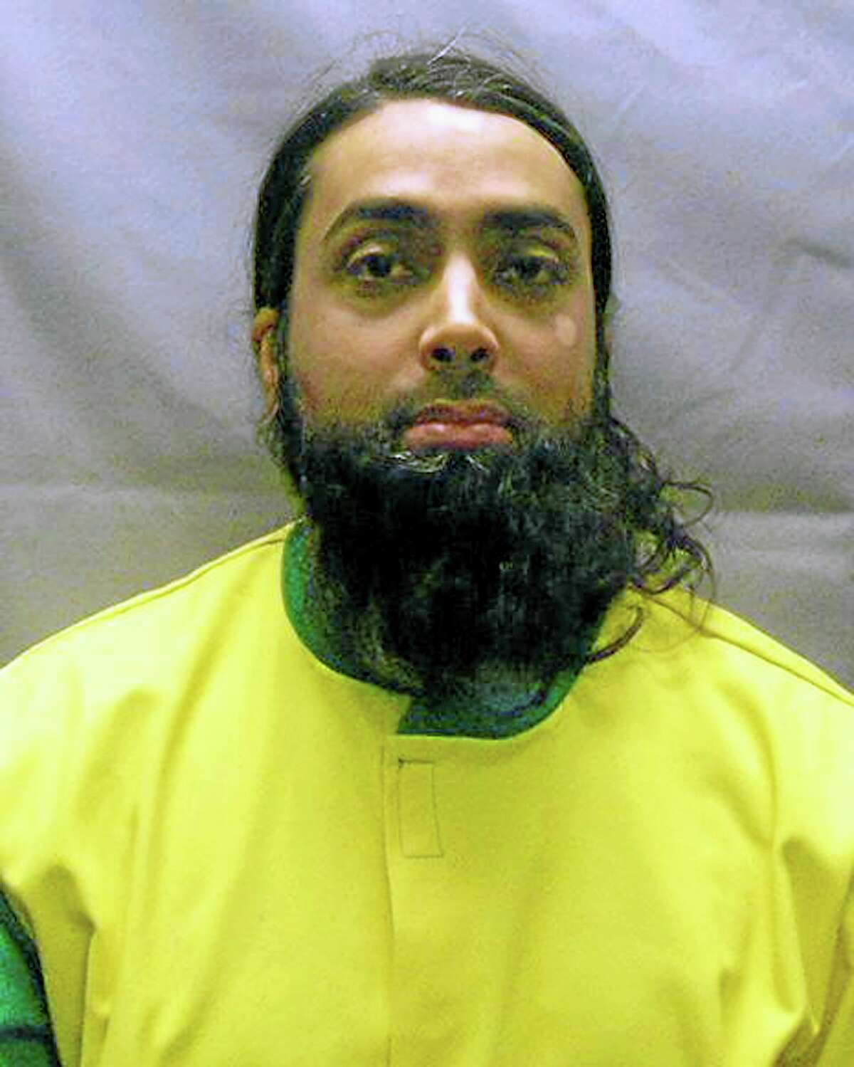 This Nov. 9, 2012, file photo provided by the U.S. Attorney's Office shows Syed Talha Ahsan, extradited with Babar Ahmad to the United States from Britain in October 2012 on charges of supporting terrorists through websites. The men, both British citizens, have pleaded guilty to the charges. Ahsan faces sentencing in federal court Thursday, July 17, 2014, in New Haven, Conn., for supporting terrorists through websites that sought to raise cash, recruits and solicit items such as gas masks for the Taliban regime in Afghanistan.