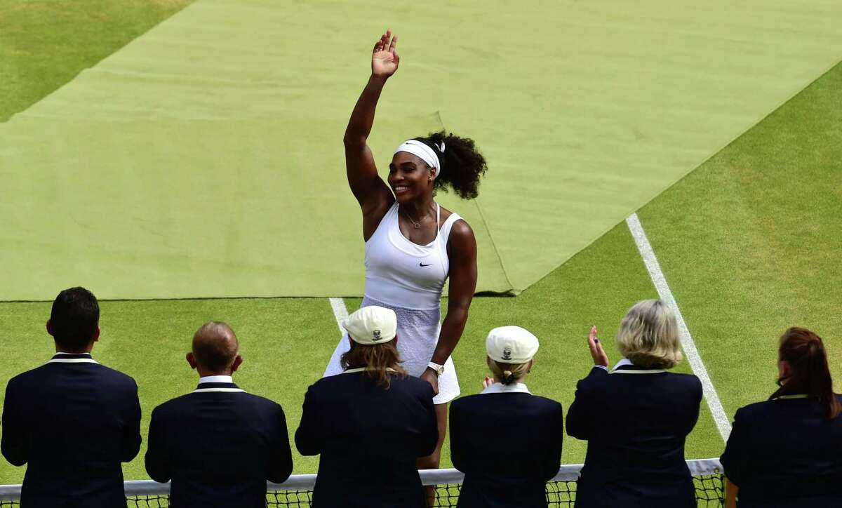 Serena Williams waves to the crowd after beating Garbine Muguruza on Saturday at the All England Lawn Tennis Championships in Wimbledon, London.
