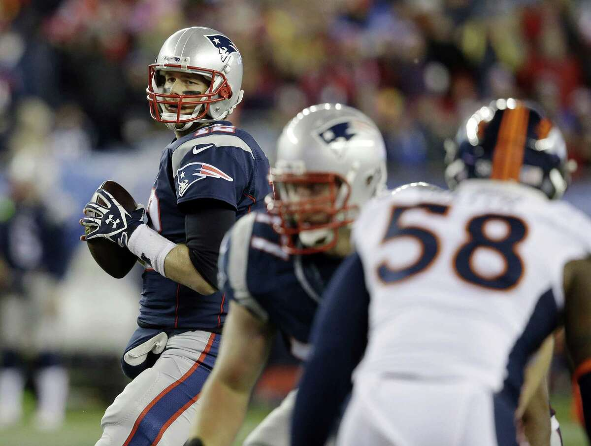 New England Patriots quarterback Tom Brady looks for a receiver against the rush by Denver Broncos outside linebacker Von Miller (58) on Sunday in Foxborough, Mass.