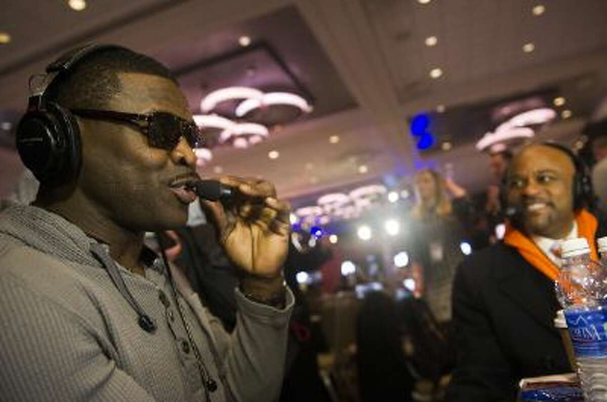 Michael Irvin, former Dallas Cowboys wide receiver and NFL Network analyst (left), talks to Denver mayor Michael Hancock on The Press Box radio show on January 31, 2014, at the Sheraton Hotel Times Square in New York,