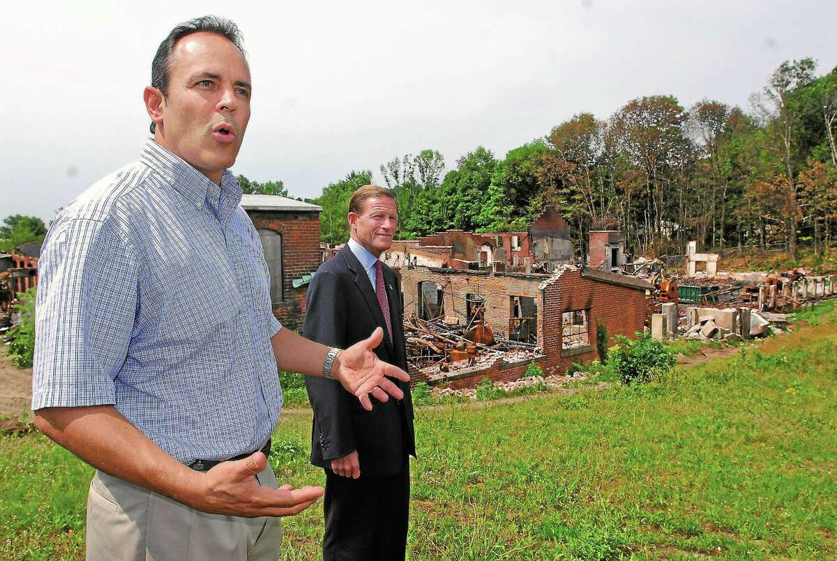 U.S. Sen. Richard Blumenthal listens as Matt Bevin, left, the sixth-generation owner of the Bevin Bros. Manufacturing Co., updates his efforts to restart the bell manufacturing in East Hampton in this July 2012 file photo. The Bevin factory was crippled by a May 27 fire.