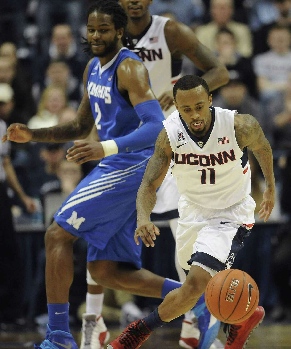Jessica Hill — The Asociated Press UConn's Ryan Boatright, right, steals the ball from Memphis' Shaq Goodwin in Thursday's game.