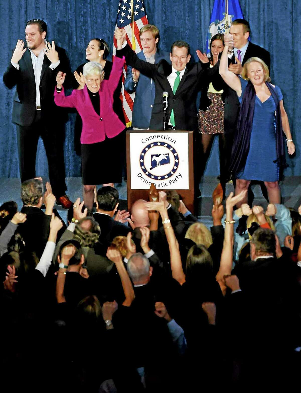 Incumbent Connecticut Gov. Malloy and Lt. Gov. Nancy Wyman,left, and Malloy's wife Cathy right, give a post-midnight speech to supporters claiming victory on election night at The Society Room in Hartford, Connecticut during a close race against Republican challenger Tom Foley Tuesday, November 4, 2014.