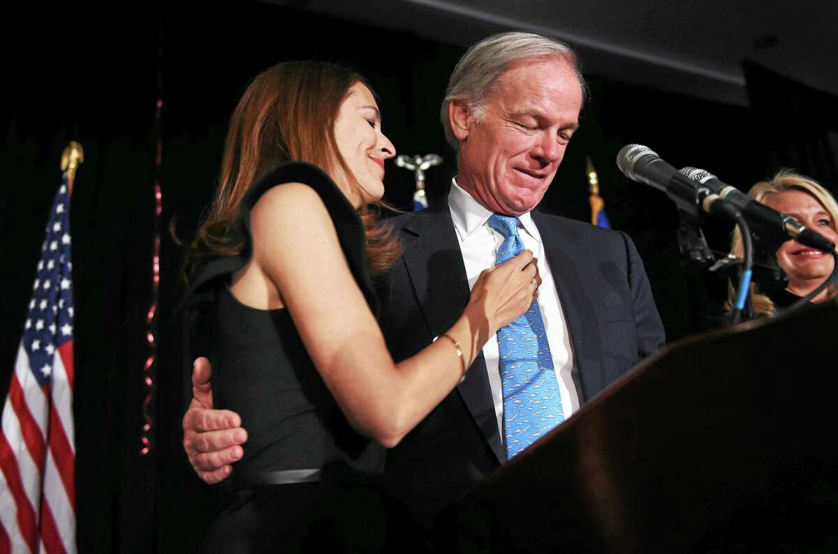 Leslie Fahrenkopf Foley (left) embraces her husband, Tom Foley, as he delivers a qualified concession in the governor's race at the Hyatt Regency in Old Greenwich on 11/4/2014.