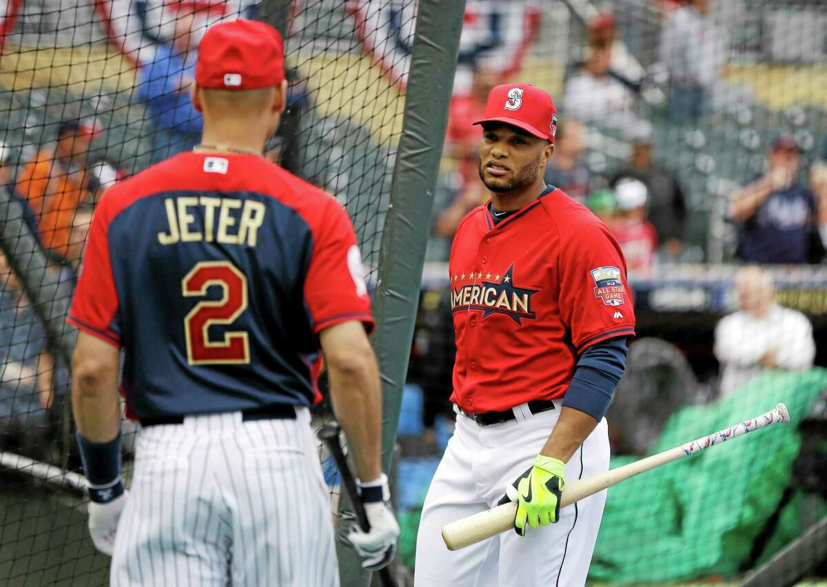 American League second baseman Robinson Cano, right, talks with Derek Jeter Monday in Minneapolis.