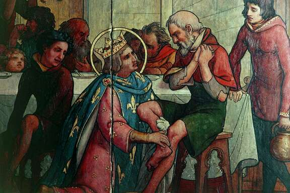 Saint Louis washing the feet of the poor, from a painting in the treasury of Notre-Dame cathedral in Paris.