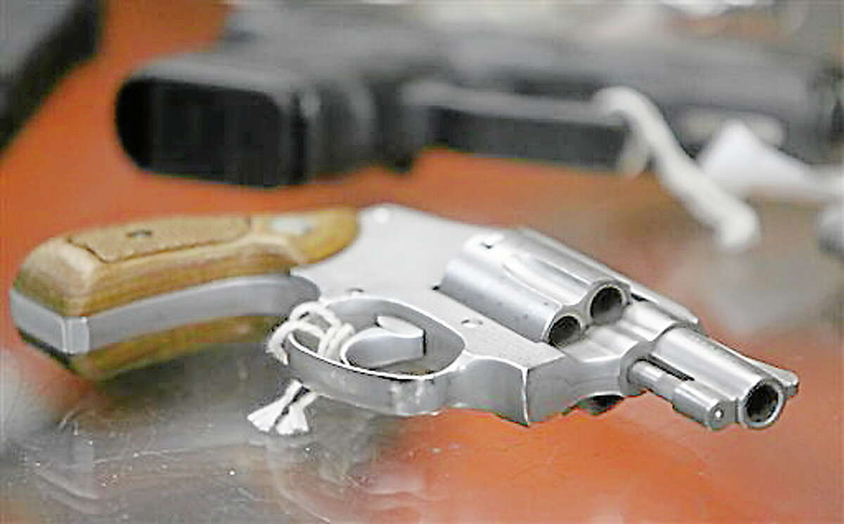 In this file photo, a chrome plated revolver rests on top of a glass display case at John Jovino Co. in New York.