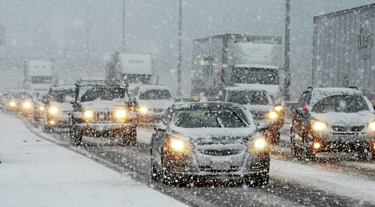 (Mara Lavitt - New Haven Register) A band of snow crossed the greater New Haven area during rush hour on Monday. I-95 southbound through Branford slowed to a crawl.