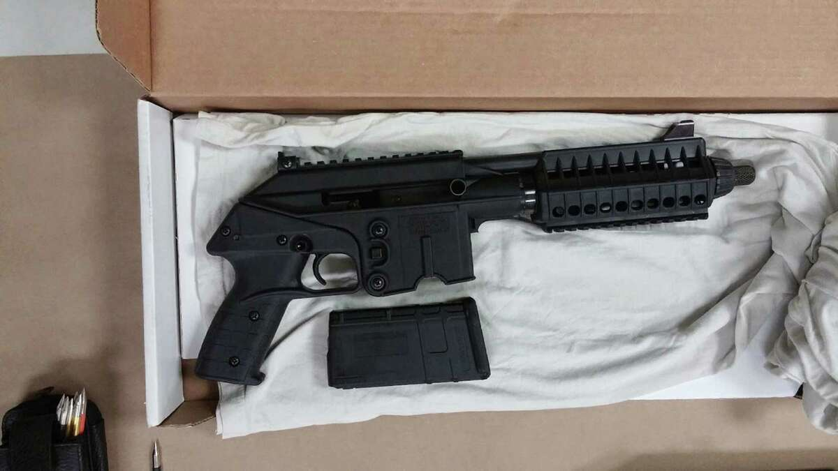 This image provided by the Prince George's (Md.) Police shows one of the weapons that police found upon searching Hong Young's home in Beltsville. Md, on Wednesday, March 4, 2015. Young, accused of firing at five public places in Maryland, including a building at the National Security Agency, chose his targets at random, police said Wednesday. Young was charged with attempted murder and assault in the first shooting Feb. 24 near a mall. Police said the other shootings were linked by ballistic evidence or surveillance video. (AP Photo/Princes George's Police)