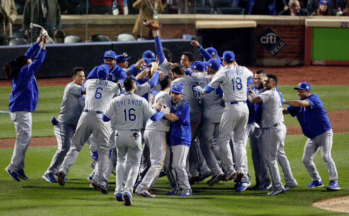 Members of the Kansas City Royals celebrate after beating the Mets in Game 5 to win the World Series on Sunday.