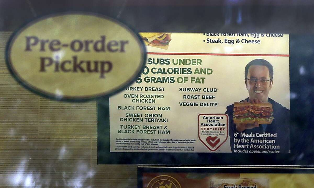 An image of Subway restaurant spokesman Jared Fogle is seen on a menu board hanging inside one of its locations, in St. Louis.