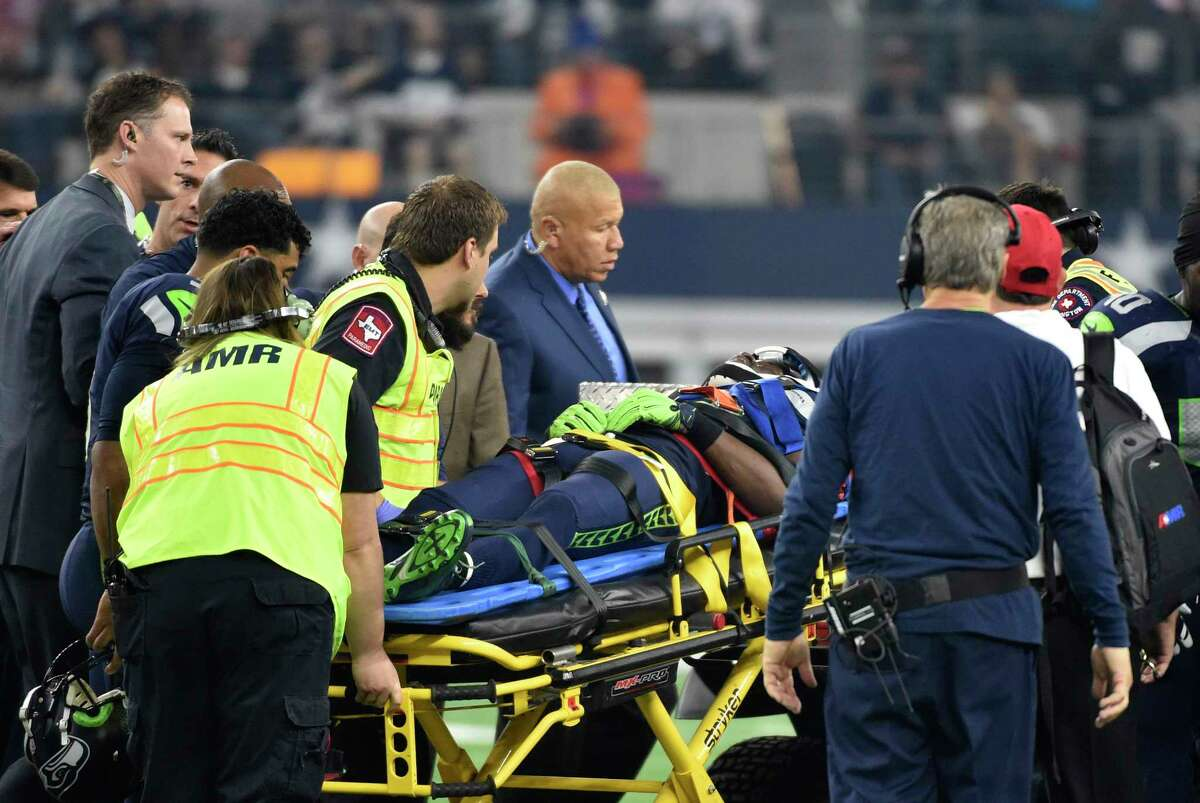 Seattle Seahawks head coach Pete Carroll, right, watches as Ricardo Lockette is attended to by medical staff during Sunday's game against the Dallas Cowboys in Arlington, Texas.