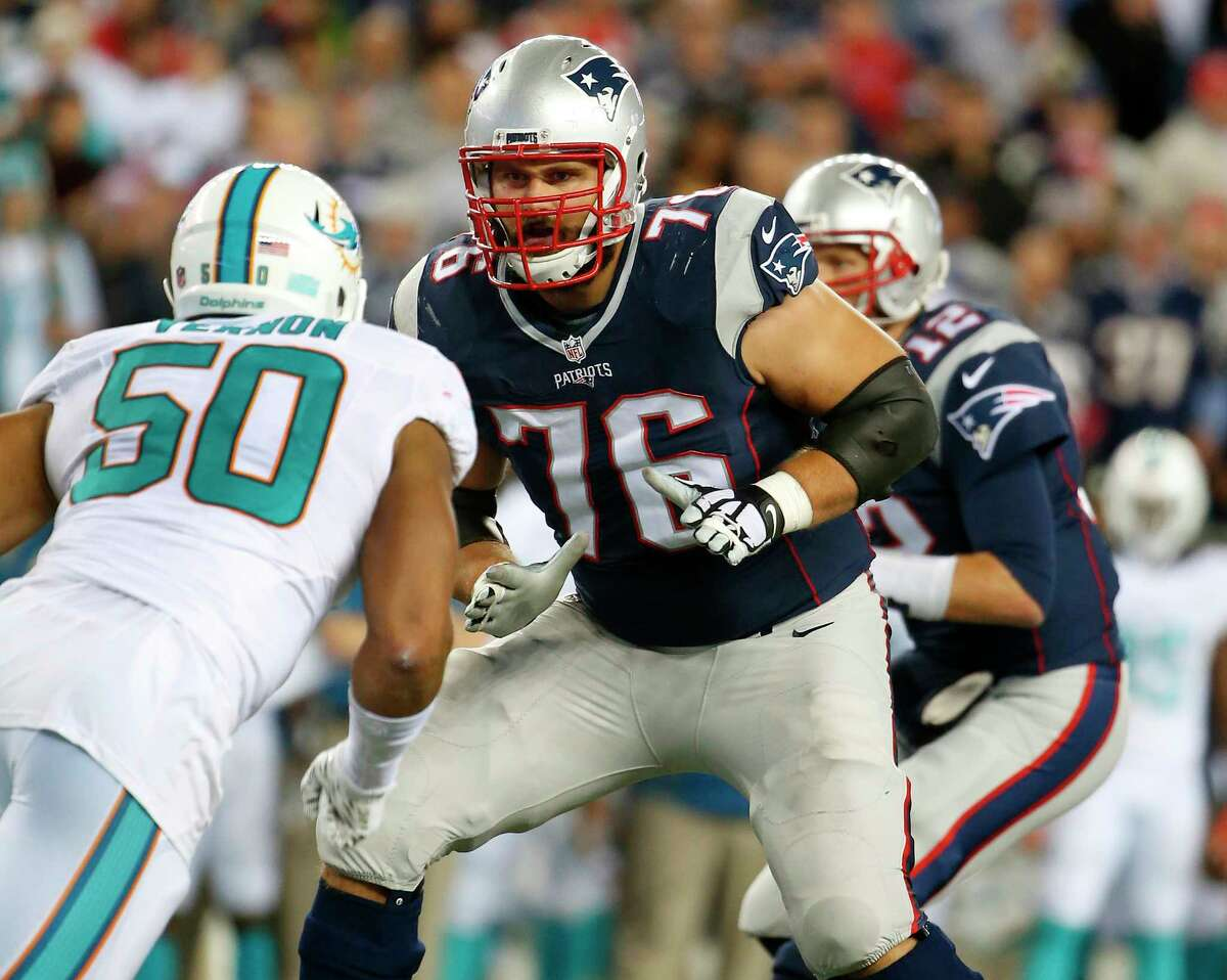 New England Patriots tackle Sebastian Vollmer blocks against Miami Dolphins defensive end Olivier Vernon during Thursday's game at Gillette Stadium in Foxborough, Mass.