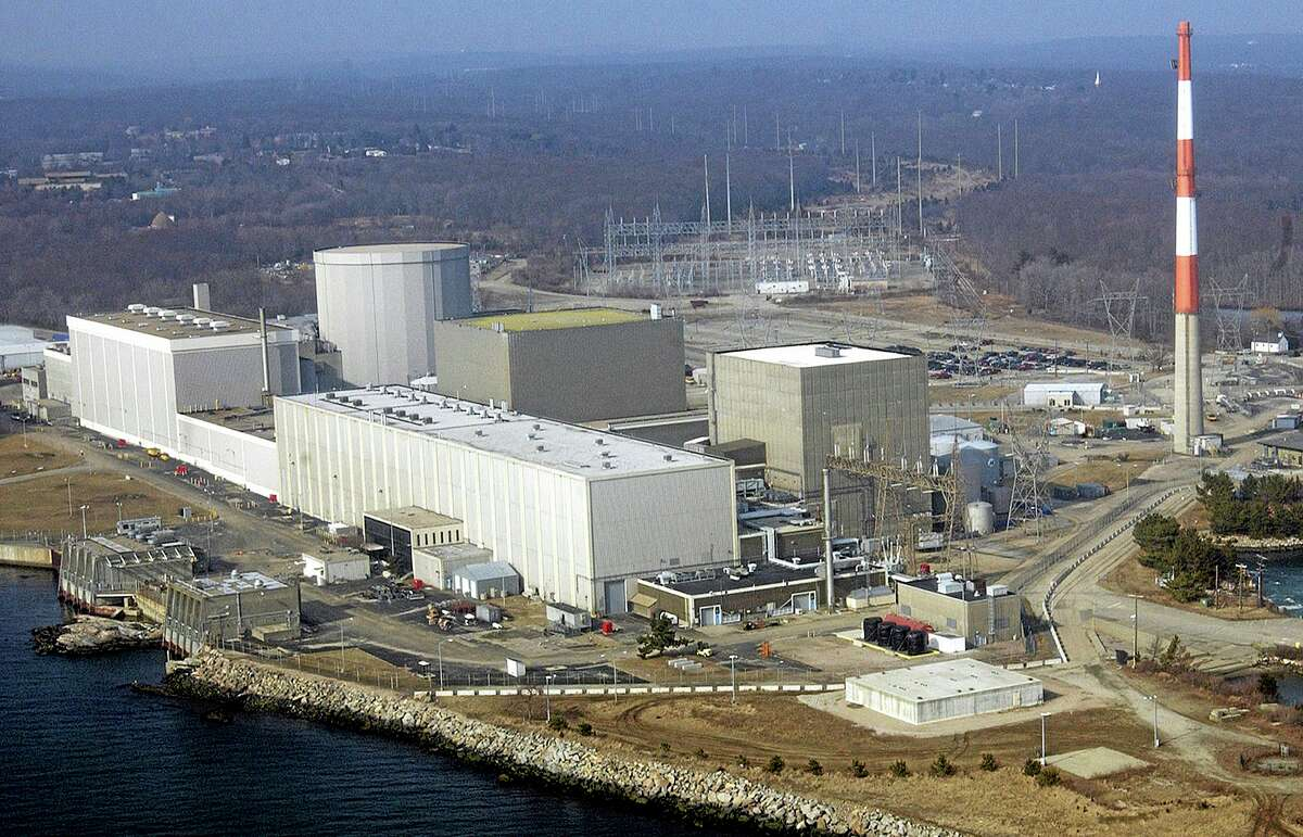 FILE - This March 18, 2003 aerial file photo shows the Millstone nuclear power facility in Waterford, Conn. Connecticut officials on Thursday, May 2, 2013 authorized the Millstone nuclear plant to significantly expand nuclear waste storage capacity from 19 cask storage units now to 135 by 2045. (AP Photo/Steve Miller, File)