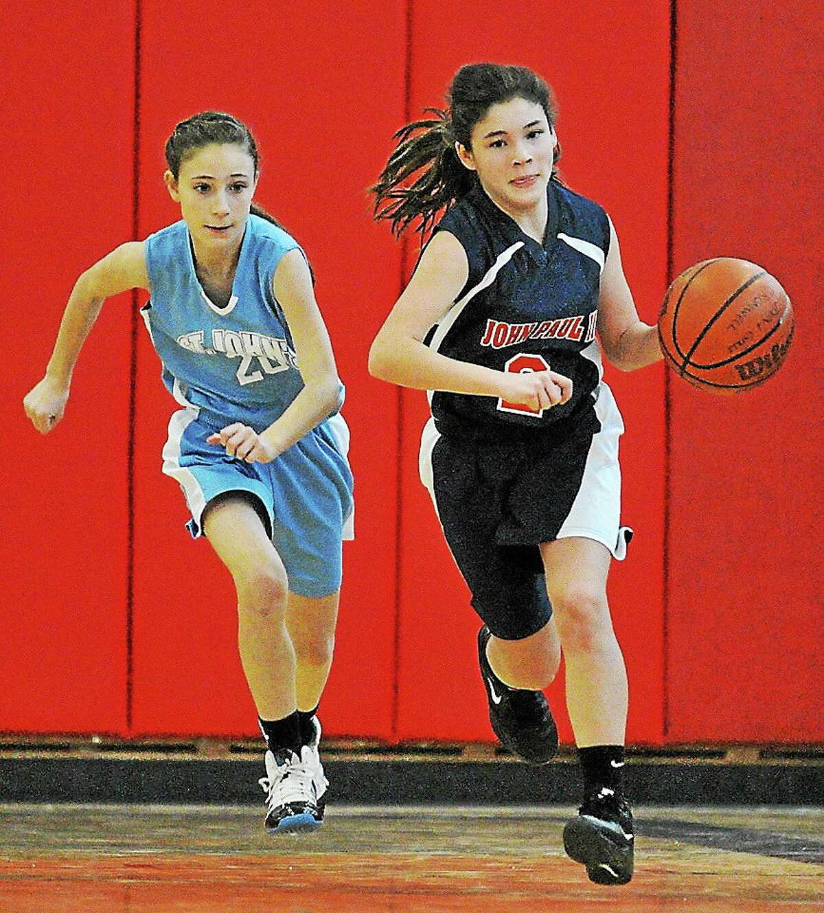 Courtesy St. John Paul II Varsity Basketball At right, eighth-grader Abbey Clemmey is a point guard for the St. John Paul II Varsity Girls Basketball Team.