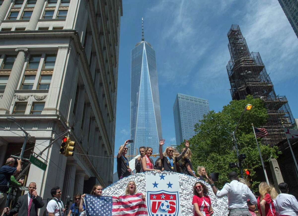 U.S. women's soccer team members are joined by New York Gov. Andrew Cuomo, second from left, as their float makes its way up Broadway's Canyon of Heroes during the parade to celebrate the team's World Cup victory on Friday in New York.