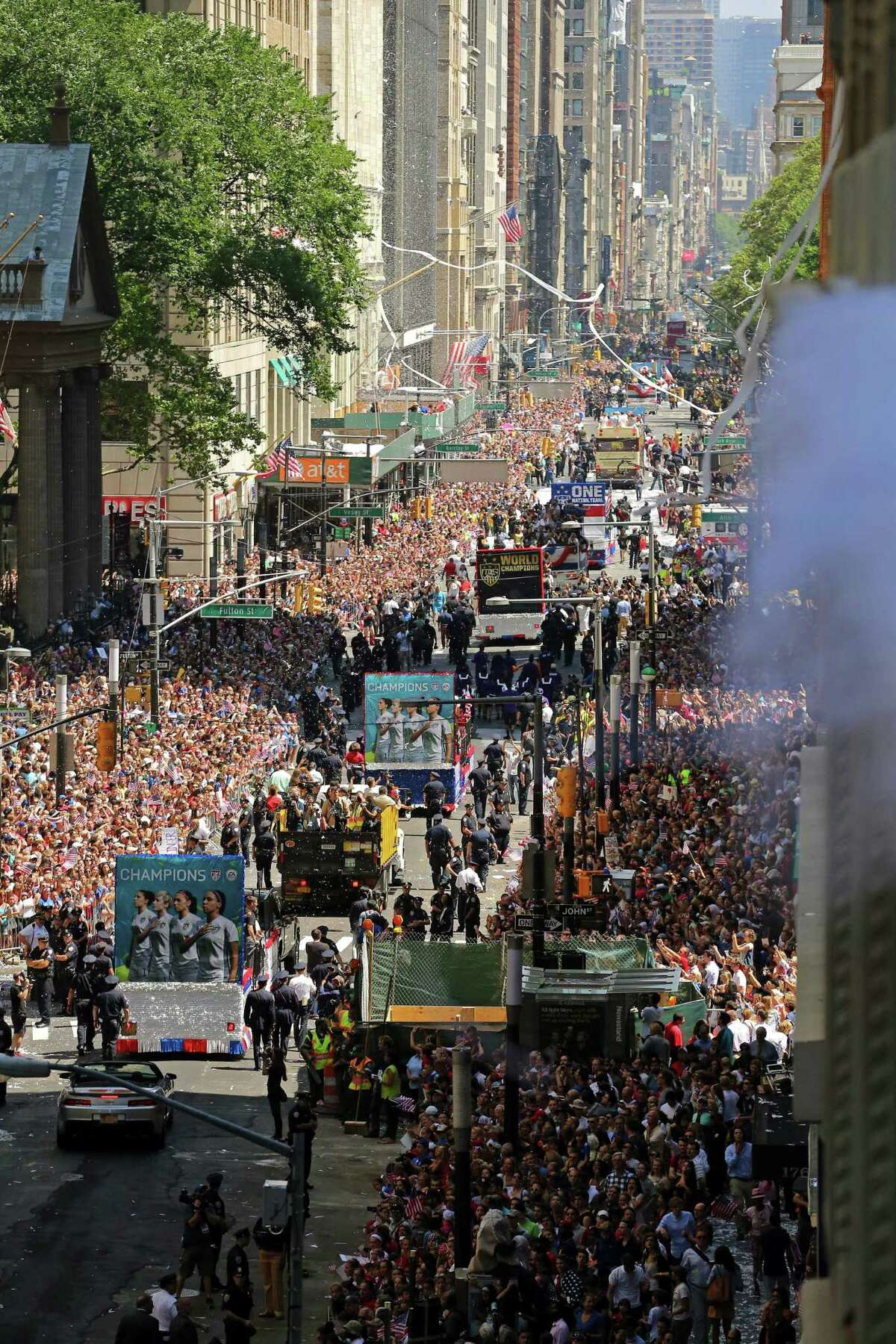 The U.S. Women's World Cup team stands on floats as they move through thousands of fans along Broadway on Friday in New York in a view from 150 Broadway.